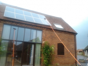 solar panels cleaned with high reach poles